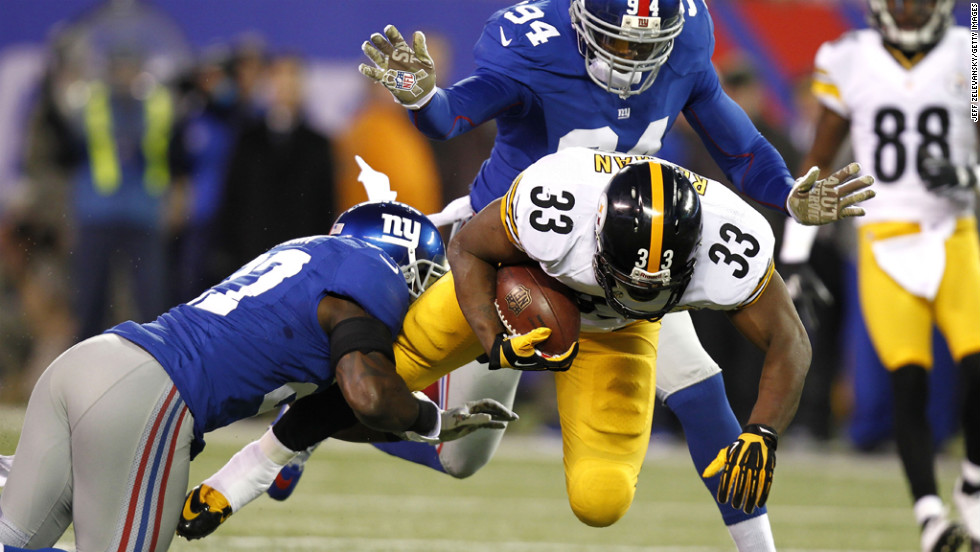 Isaac Redman of the Steelers tries to break away from Stevie Brown of the Giants.
