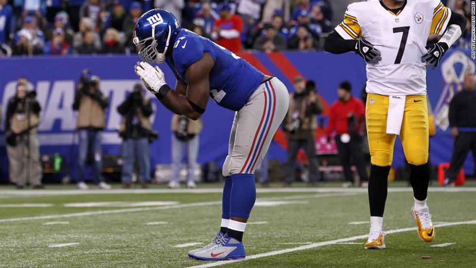 Justin Tuck of the Giants celebrates a sack.