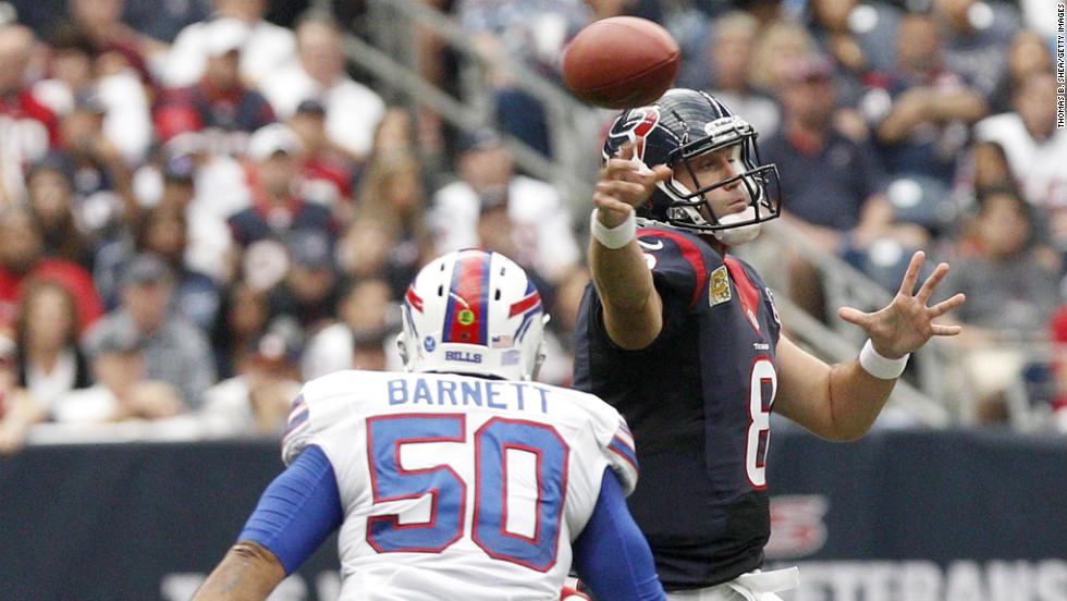 Texans quarterback Matt Schaub completes a pass while being pressured by Bills linebacker Nick Barnett.