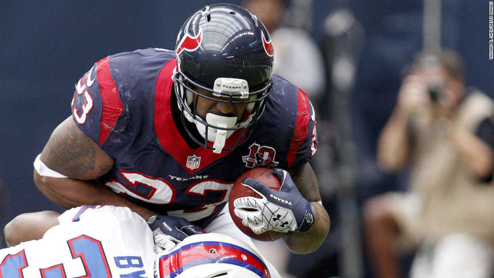 Texans running back Arian Foster is tackled by Bills safety Jairus Byrd.