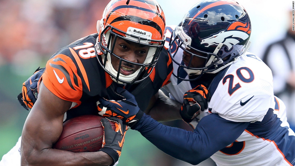 Bengals wide receiver A.J. Green runs with the ball while being defended by Mike Adams of the Broncos.