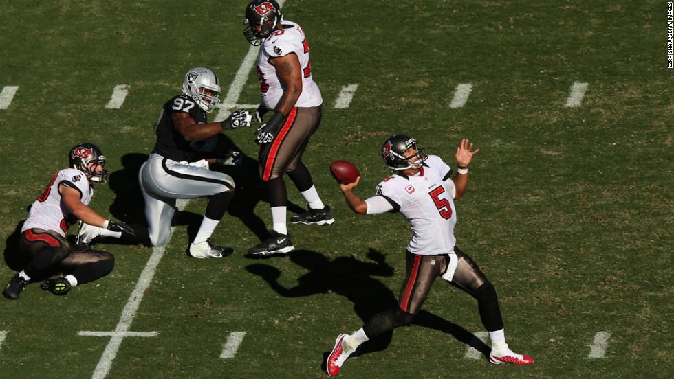 Buccaneers quarterback Josh Freeman looks for an open receiver.