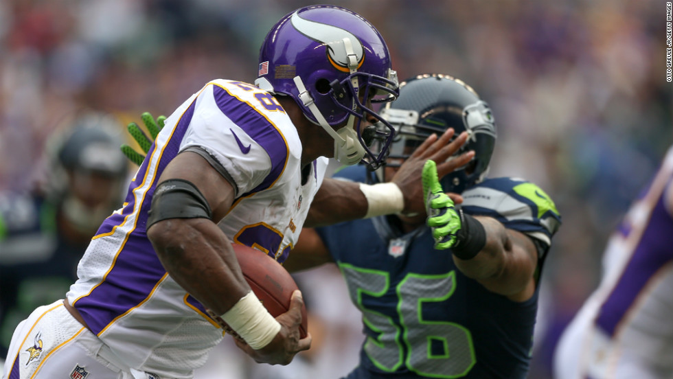 Running back Adrian Peterson of the Minnesota Vikings rushes against Leroy Hill of the Seattle Seahawks at CenturyLink Field on Sunday, November 4, in Seattle.