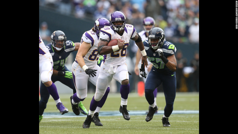 Running back Adrian Peterson of the Vikings rushes against the Seahawks on Sunday.