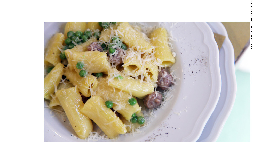 Freshly made rigatoni with a white ragout of cannellini beans, rosemary, small sausage meatballs and peas is a simple, yet unforgettable, dish.