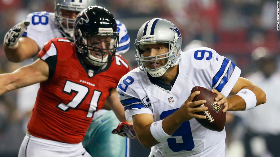 Quarterback Tony Romo of the Dallas Cowboys is pressured out of the pocket by Kroy Biermann of the Falcons.