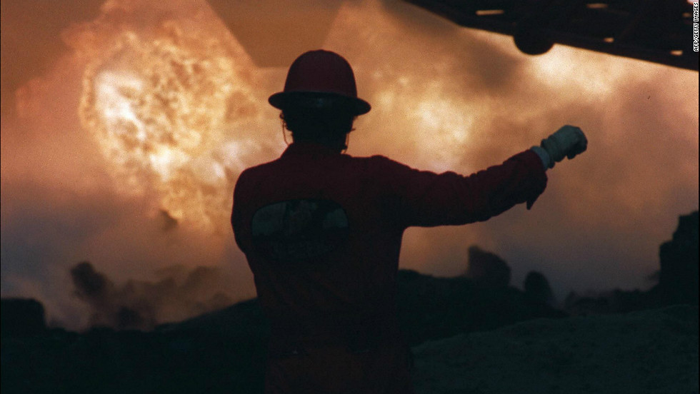 A firefighter works to extinguish a blaze in a Kuwaiti oilfield -- set ablaze by retreating Iraqi soldiers -- in April 1991.