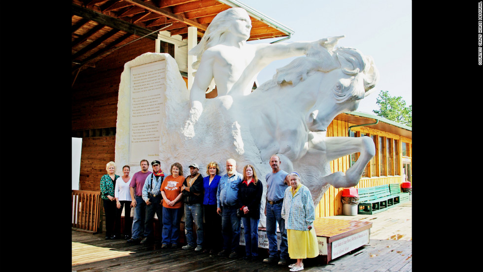 Ziolkowski's 10 children and his wife, Ruth, stand in front of a model of what the Crazy Horse mountain will look like when complete.