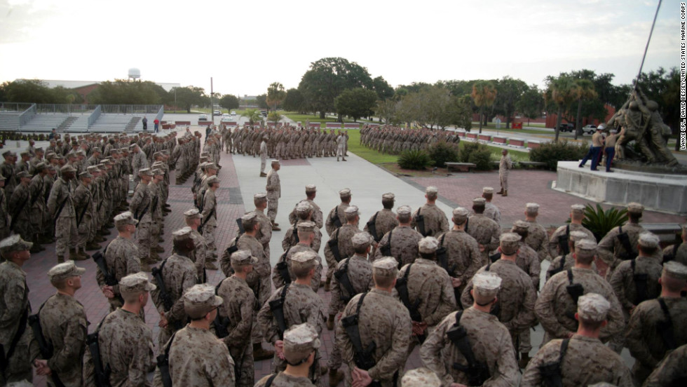 "Recruits of Bravo Company, 1st Recruit Training Battalion, gather at Parris Island's Iwo Jima statue to receive their Eagle, Globe and Anchors last August. Each drill instructor presents their recruits with a small eagle globe and anchor emblem, shakes their hands, calls them Marines for the first time and tells them, ""job well done."""