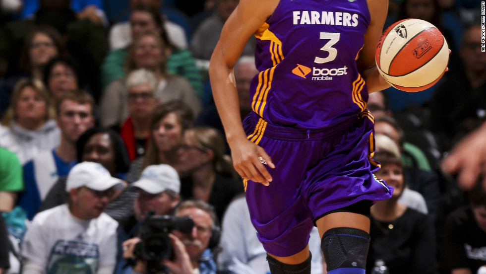 Travel is a fact of life for professional basketball player Candace Parker, shown here playing with the WNBA's L.A. Sparks.