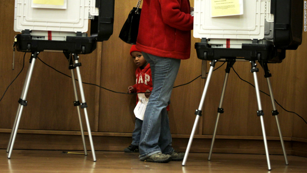 Two-year-old Ariel Ferreras accompanies his mother, Erika, as she votes in Silver Spring, Maryland, on Friday, November 2. Voters in Maryland broke the state's record for early voting turnout.