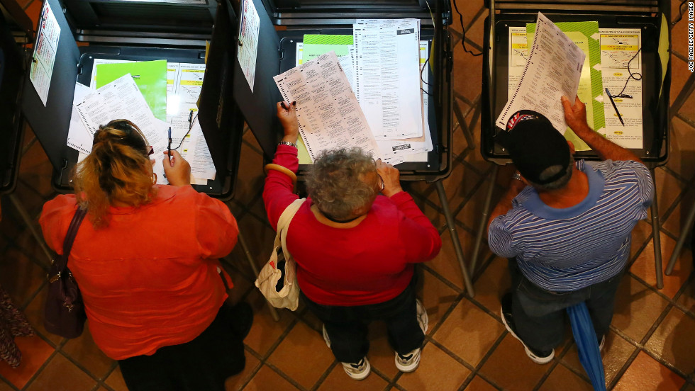 Early voters fill out their ballots on the first day of early voting in Miami on October 27. Early voting in the swing state of Florida was held for eight straight 12-hour days.