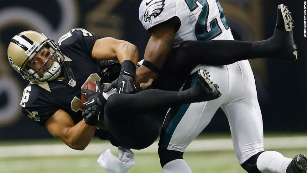 Lance Moore of the New Orleans Saints catches a pass over Dominique Rodgers-Cromartie of the Philadelphia Eagles.