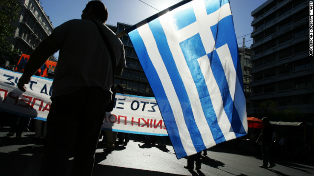 rotesters march outside parliament during a rally on November 6, 2012 in Athens, Greece. Thousands of Greeks are protesting against further austerity measures as a two-day general strike begins ahead of a crucial Parliamentary vote for emergency cuts and tax increases.