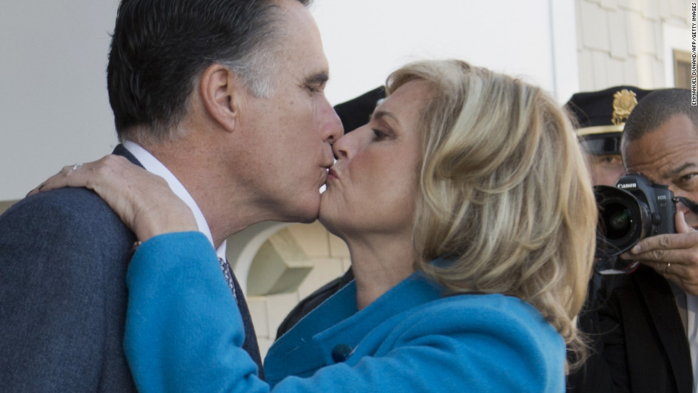 Mitt Romney and his wife, Ann, kiss after casting their votes in Belmont, Massachusetts.