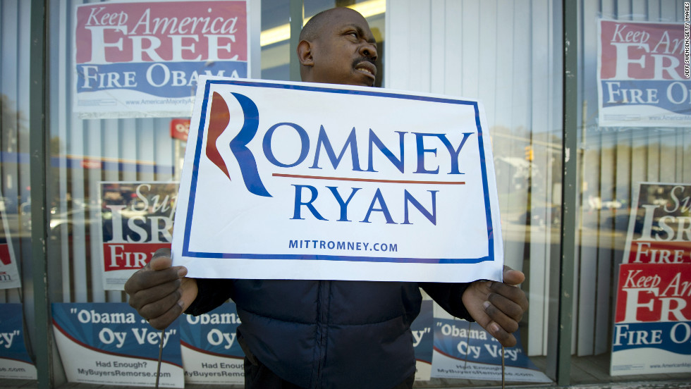 James Tate, 45, held a sign in support of the Republican ticket in Pittsburgh, Pennsylvania.