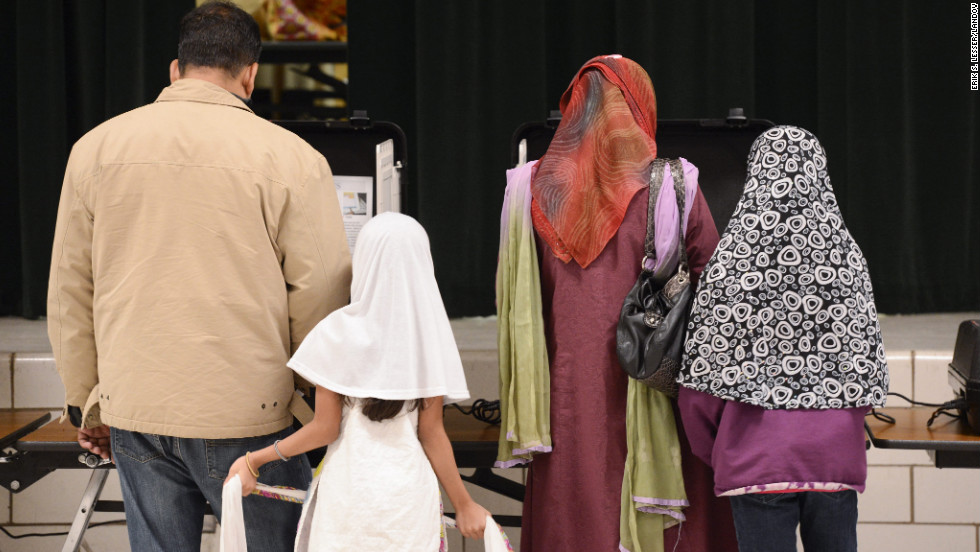 Adults of the Uddin family, originally from Bangladesh, vote together at the Hightower Elementary School polling site in Doraville, Georgia.