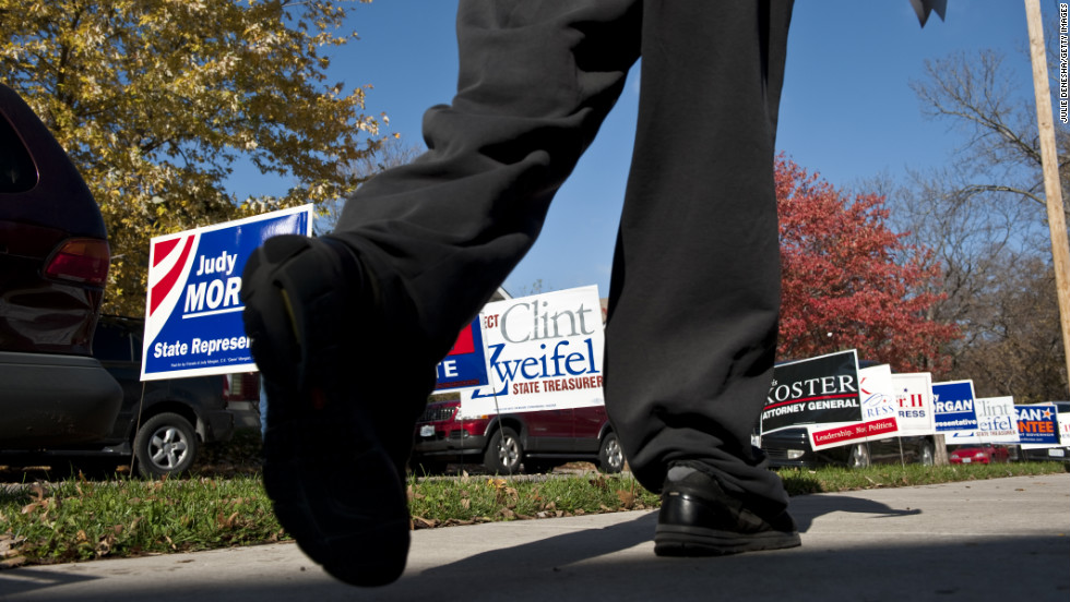 Voters walked past a plethora of campaign signs after casting their ballots at Immanuel Lutheran Church in Kansas City, Missouri.
