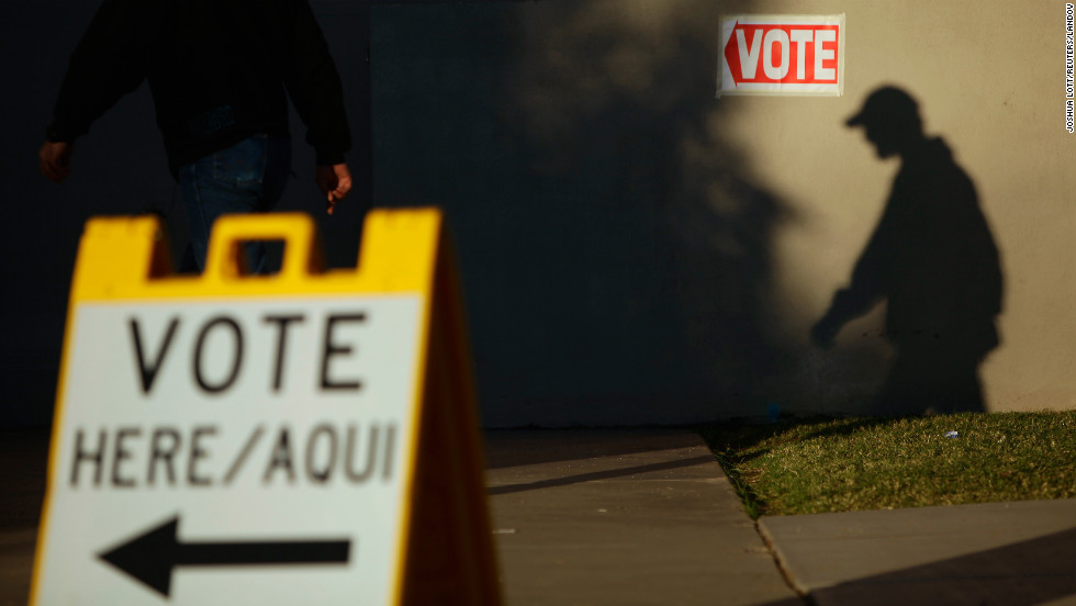 A voter's shadow appears on the wall as he arrives at a Phoenix, Arizona, polling station Tuesday.
