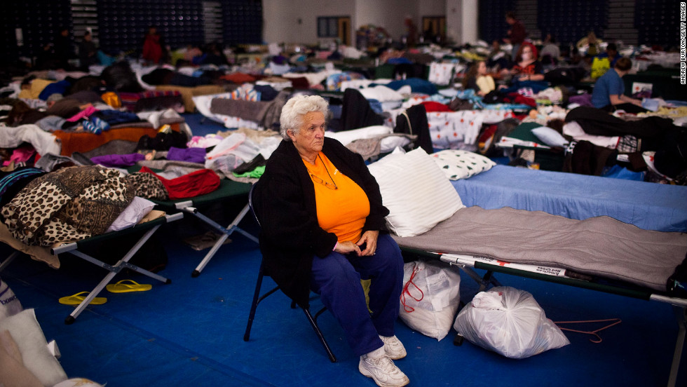 Ruth Hawfield sits next to her cot Monday in a Red Cross evacuation shelter at Toms River High School.