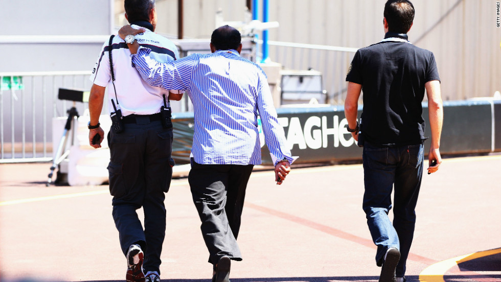 Perez's father, center, leaves the paddock after the F1 driver's crash during qualifying for the Monaco GP in 2011. Perez's younger brother Antonio is also involved in motorsport and drives in the NASCAR-sponsored race league in Mexico.