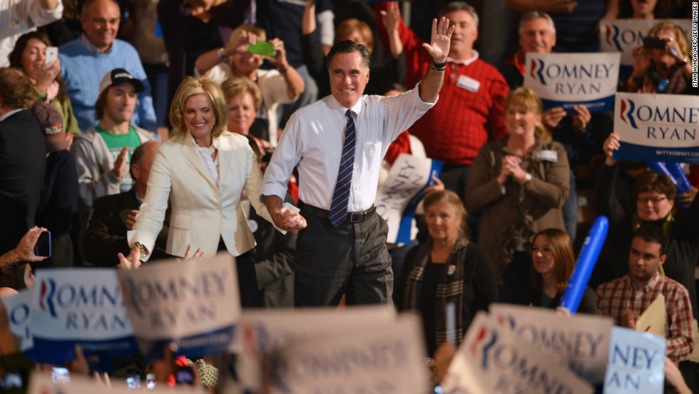 Romney and his wife, Ann, greet supporters at a rally late Monday in Manchester, New Hampshire.