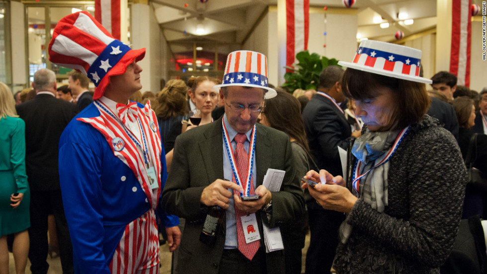 Party-goers wearing 'Stars and Stripes' clothing awaited results at an election night party at the U.S. Embassy in London.