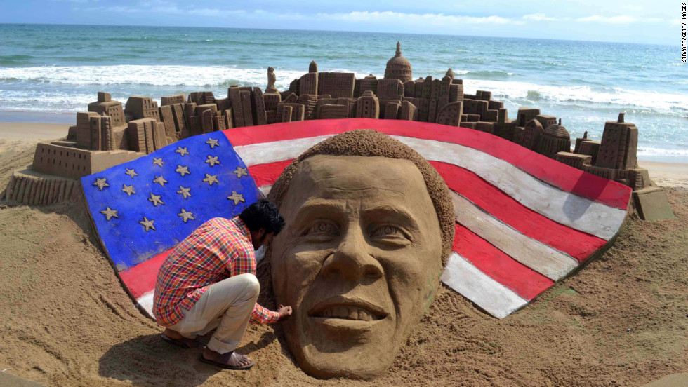 Indian artist Sudaran Pattnaik adds final touches to his sand sculpture of Obama at Golden Sea Beach in Puri, India, on Wednesday.