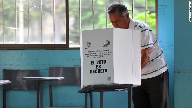 A man casts his vote during the referendum called by President Rafael Correa, at the Huancavilca school in Guayaquil, Ecuador on May 7, 2011.