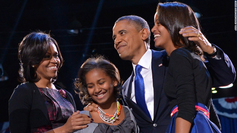 President Barack Obama embraced first lady Michelle Obama and daughters Sasha and Malia moments before he delivered a rousing victory speech.