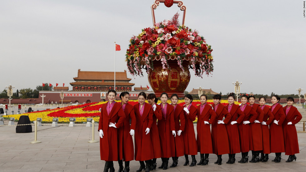 Attendants pose for a picture in Tiananmen Square on November 7.