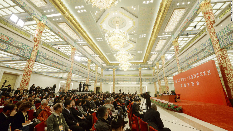 Members of the press gather inside the Great Hall of the People for a briefing on November 7.