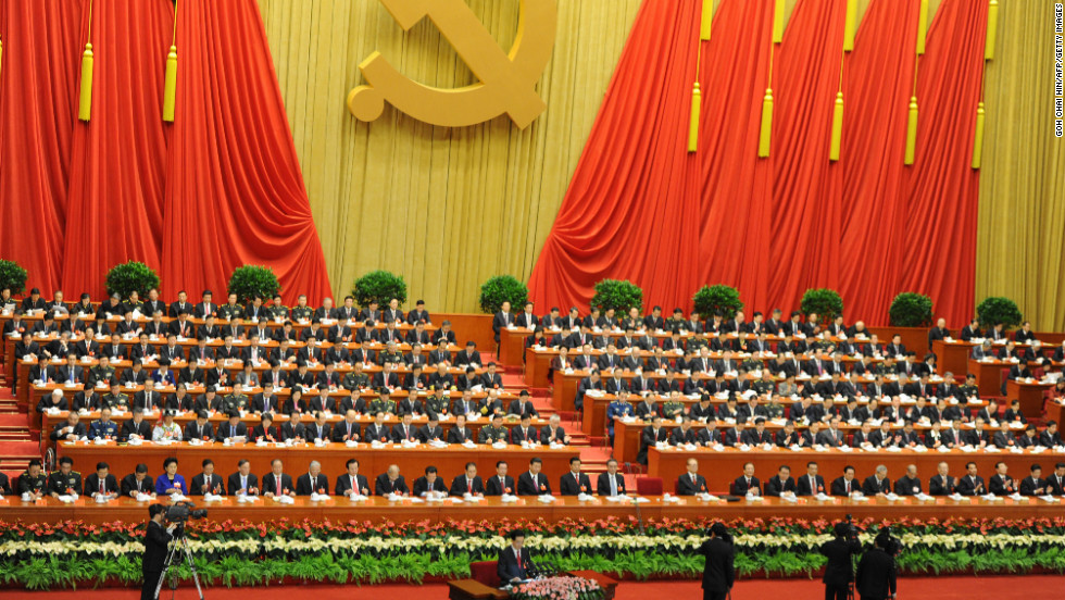 Chinese President Hu Jintao (seen at the very bottom) addresses delegates on November 8.