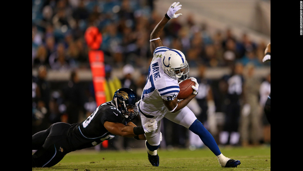 Colts wide receiver Reggie Wayne is tackled after a catch Thursday.
