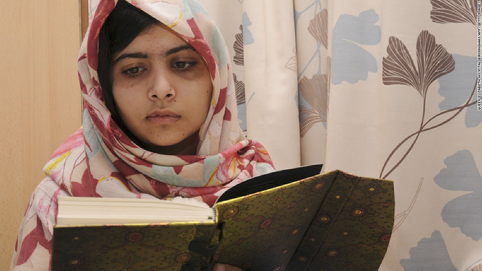Malala Yousufzai, 15, reads a book on November 7, 2012 at the hospital.