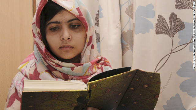 A handout picture taken on November 7 shows injured 15 year-old Pakistani schoolgirl Malala Yousafzai reading a book at the Queen Elizabeth Hospital in Birmingham, England.