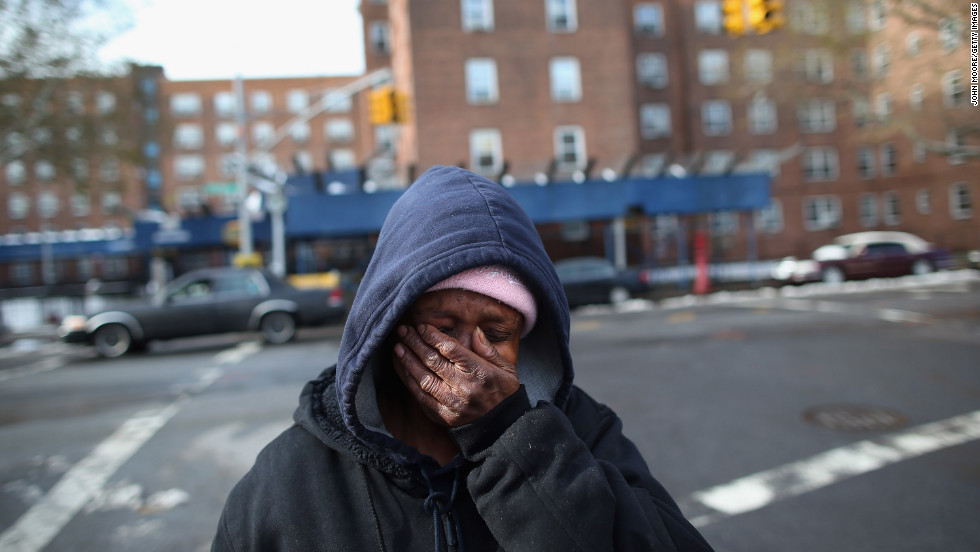 Theresa Goddard, her apartment still without electricity, is overwhelmed while discussing her living conditions on Thursday, November 8, in the Brooklyn borough of New York.