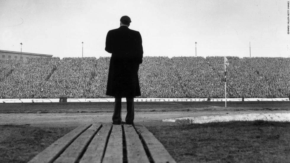 Graham speaks to fans at Stamford Bridge, London, during halftime at a football match between Chelsea and Newcastle United on April 24, 1954.