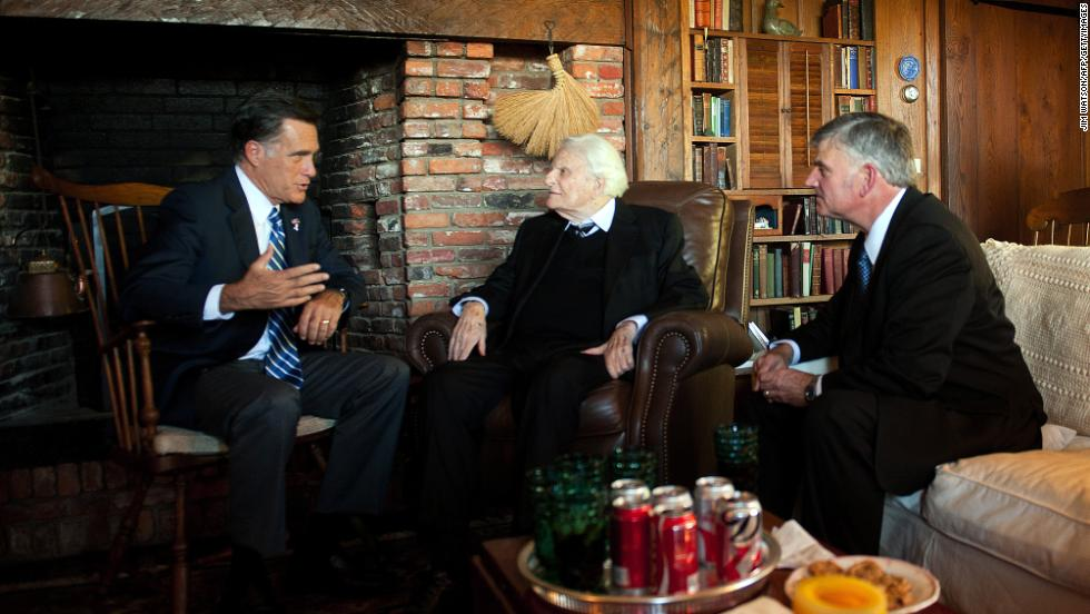 Republican presidential candidate Mitt Romney speaks with Billy and Franklin Graham during a visit to the Grahams' cabin in Montreat on October 11, 2012.