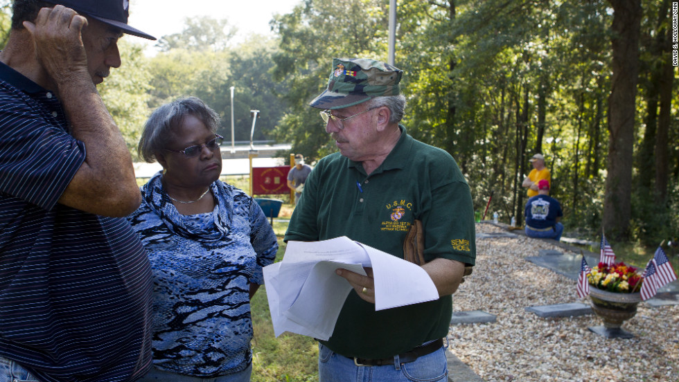 Volunteers from Macon's African-American community and Marine veterans organizations have been working to clear Linwood and build a lasting monument to Davis, Macon's only Medal of Honor recipient.  Here, Davis' older brother Gordon, Gordon's wife, Josephine, and Nicholas Warr, a Vietnam veteran, discuss the project.