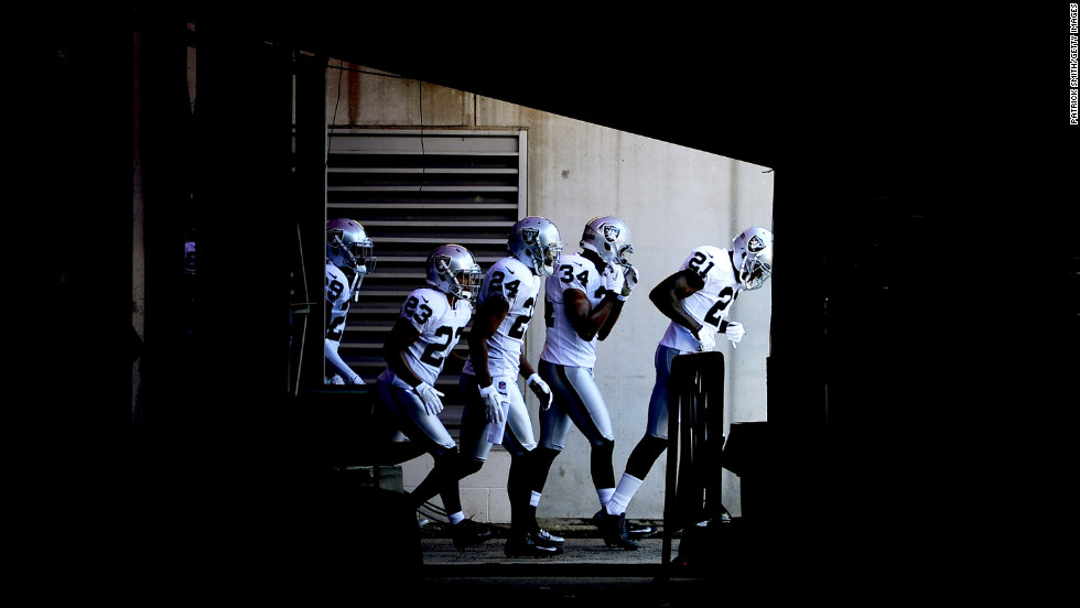 The Oakland Raiders take the field before playing the Baltimore Ravens at M&T Bank Stadium on Sunday in Baltimore, Maryland.