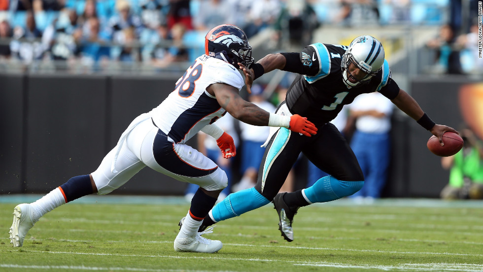 Von Miller of the Broncos tackles quarterback Cam Newton of the Panthers during their game on Sunday.