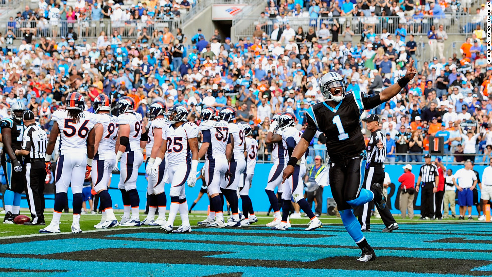 Cam Newton of the Panthers reacts after his team scores a touchdown against the Broncos on Sunday.