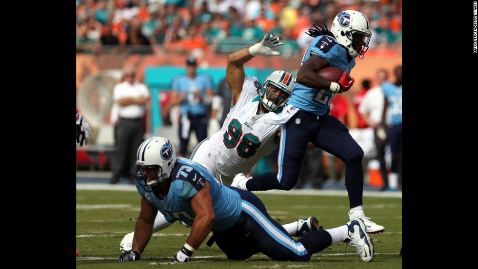 Running back Chris Johnson of the Titans runs against the Dolphins on Sunday.
