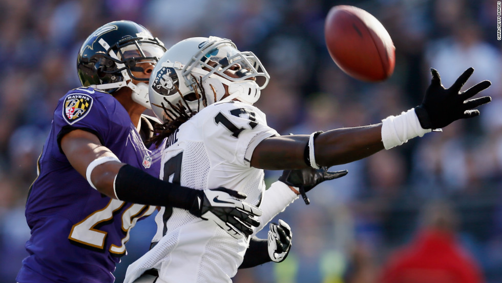 Cornerback Cary Williams of the Ravens breaks up a pass intended for wide receiver Denarius Moore of the Raiders during the first half on Sunday.
