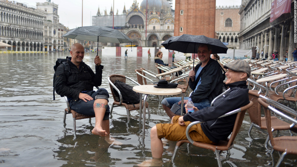 The city's famed St Mark's Square was left under several feet of water -- but some visitors were determined to enjoy the view, whatever the weather.