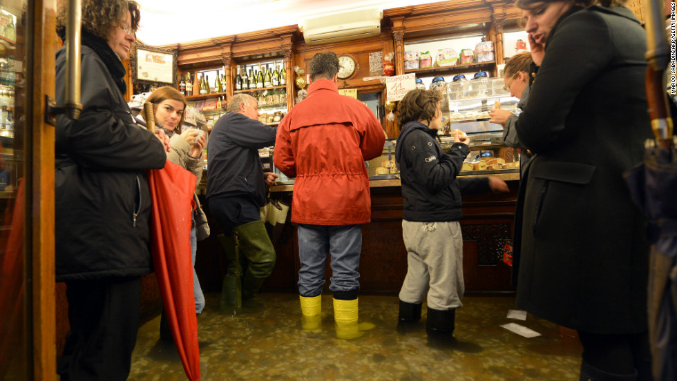 Others donned rubber boots for a visit to one of the city's cafes.
