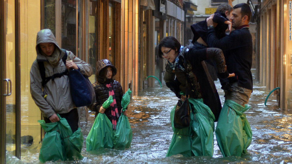 "Others fashioned improvised ""waders"" out of plastic bags in an effort to keep their feet dry."