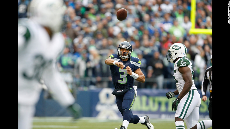 Quarterback Russell Wilson of the Seattle Seahawks throws in the first half against the New York Jets at CenturyLink Field on Sunday in Seattle. Seattle defeated the New York Jets 28-7.