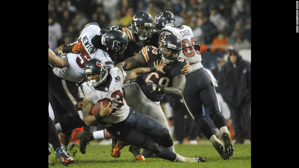 Arian Foster of the Houston Texans is tackled by Henry Melton of the Chicago Bears on Sunday at Soldier Field in Chicago. The Texans defeated the Chicago Bears 13-6.